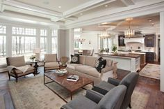 Spacious traditional style open space with floor to ceiling winnows in earthy single color scheme.
