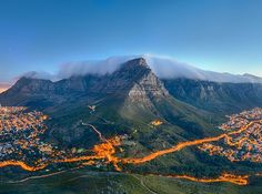 Table Mountain, South Africa The most iconic landscape in South Africa, Table Mountain looks over Cape Town from 3,558 feet above the sea. You can see its flat peak from almost anywhere in the city, often surrounded by clouds.