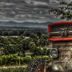Massey Ferguson tractor in the Hunter Valley, Australia. love this picture with the storm clouds in the back!