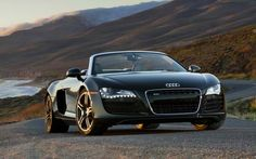"""It's one of those cars that should have a very leggy blonde, wearing nothing but a sash, sprawled across the hood. """"Nice car."""" """"I know."""" """"So what sort of car is this?"""" """"It's an Audi R8 Spyder."""""""