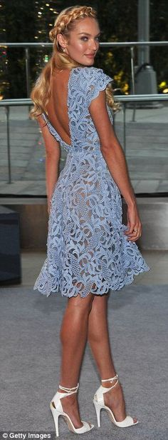She can do demure too: The model looked pretty in a lacy frock at the CFDA Fashion Awards last week #beautydresses