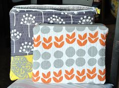 The orange and grey case...what a cute quilt idea! I love the imperfect circles and happy tulip leaflets!
