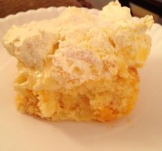 (Pig Licking Cake)  -Dump 2 large cans (regular size not those mini ones) mandarin oranges into a yellow cake mix with one egg and 1/4 cup of oil. Bake temp per box. Topping-One tub of Cool Whip mixed with one box of vanilla pudding and one can of crushed pineapple drained... Mix together.. Spread on cooled cake and keep refrigerated.