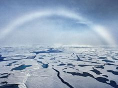 "a rare phenomenon in the Arctic sky - white arc known as ""foggy"" rainbow"