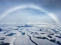 "a rare phenomenon in the Arctic sky - white arc known as ""foggy"" rainbow"