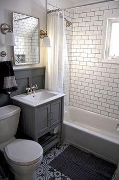 Bathroom - Small grey and white bathroom renovation update Subway tile, grey vanity, recessed cabinet, decorative tile, subway tile Diy Bathroom Remodel, Bathroom Renos, Bathroom Flooring, Bathroom Interior, Bathroom Small, Bathroom Grey, Glass Bathroom, Gray And White Bathroom Ideas, Light Bathroom