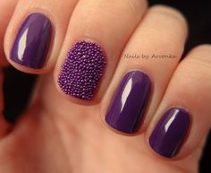 Bright purple nails with matching caviar detailing will add color and class to your manicure! Great for day and night.