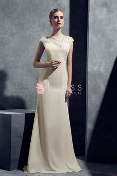 Vintage champagne chiffon evening dress. Adorned with glamorous and exquisite lace appliques to the bateau neckline and side line this full-length style will skim your shape to the floor with grace.