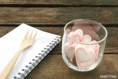 """Download the royalty-free photo """"The lovely pink heart marshmallows in round glass and white note book with wooden fork on old deep brown planks for Valentine's day."""" created by phasuthorn at the lowest price on Fotolia.com. Browse our cheap image bank online to find the perfect stock photo for your marketing projects!"""