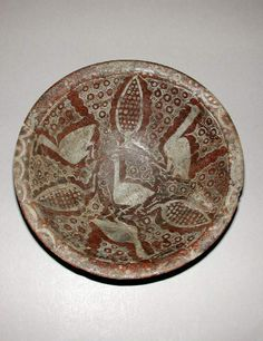 Maker: Unknown; potter Collection: Oscar Raphael Category: glazed earthenware Name(s): bowl Islamic pottery; category slip-painted ware; category Date: circa 900 — circa 999 School/Style: Samanid Period: 10th Century