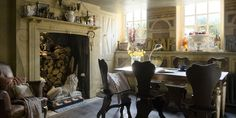 Finnish dining room, artful, collectibles, antique chairs, huge fireplace