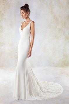 Eddy K Style SEK1187  Colors:      Ivory/Ivory     Soft Crepe/Sequin Lace        Contact a store and book your appointment today