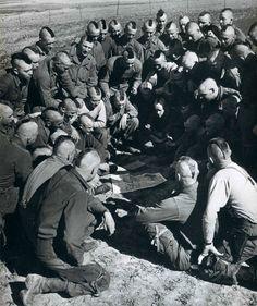 U.S. Paratroopers being briefed Rhine Jump, France 1945 (Notice the hair!)