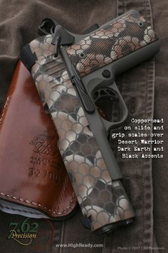 Snake skin 1911. I don't normally like gucci designs on guns, but that's just cool.