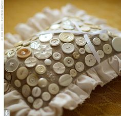Ring bearer pillow embellished with vintage buttons. Wish I'd seen this before my nephew's wedding last month.