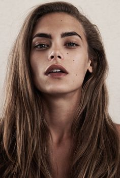 sheer foundation, defined eyes with cream contouring, stained lips, emphasis on brows.  Textured rough blow dry.