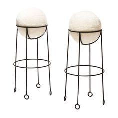"""Ok, so not sure how these would be to sit on, but who would sit on these little sculptures?    Pair stools with """"yo-yo"""" feet in iron by Jean Royère"""