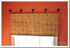 No-Sew Faux Roman Shade  Window treatments help determine the visual mood of a room.    Even though I know how to sew, I wanted to try to make a treatment that looked like a Roman Shade without sewing.    Home Depot had these self adhesive hooks by 3M for around $2 and Target had simple curtain ring clips.  (2-15-11 blog)