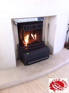 """EcoGrate – An excellent fireplace appliance for better heat emission """"Eco-friendly, cost-effective and increases the heat output? Tree Branches, Art Pieces, Old Things, Home Appliances, Eco Products, Open Fireplace, Wood, Link, Ireland"""