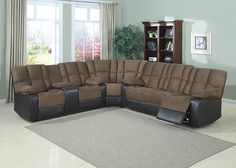 DAVID Create a comfortable and inviting living room with the David 3 Piece Sectional. Full, soft padded arm rests, back rests, and seats are covered in soft mocha colored fabric nestled against supple dark brown leatherette. David is comprised of a sofa with manual reclining seats, a corner wedge, and a loveseat with manual reclining seats, a storage console, and cup holders.