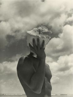 herb ritts he took this at the beach but i like the way he has worked with the things around him . just because he is something you a new way to look at the picture. and he bring more idea just by creating this picture.