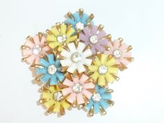 Vintage Retro Gold tone plastic and crystal Daisy Flower Spray Brooch Pin by UKVintageCurios on Etsy