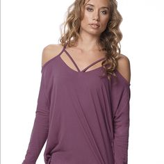 Karma Bell Longsleeve in Dusty Rose  NWT  Awesome workout cover-up or shirt to throw on as you leave the yoga / barre / Pilates studio and head out on errands & brunch! Exaggerated, straight silhouette cover up with neckline strap details and open back. Pairs effortlessly with your favorite tights. Made with soft and lightweight Boo Tissue, a natural & sustainable blend that wicks moisture. Size Small. NWT. 1st and 2nd pic show the color of this top best. I have great deals on bundles so…