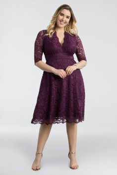 With a scalloped surplice neckline, sheer 3/4-sleeves, and a soft A-line skirt, this feminine lace party dress was designed specifically to flatter plus-size figures.  By Kiyonna  Nylon, spandex, polyester  Pullover styling; fully lined  Dry clean  USA