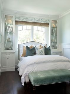 love the built-ins either side of the bed forming an alcove for the bedframe & the double layer romans. via: Barclay Butera Interiors -- beach house