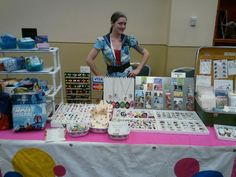 How to make money at craft shows! Me, behind my booth at CoastCon, a sci-fi convention in Biloxi, MS