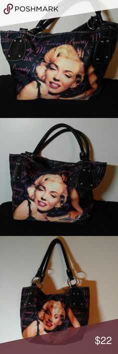 Marilyn Monroe Forever Beautiful Purse Marilyn Monroe Forever Beautiful Purse- Excellent Condition !! Purse Measures 17 X 10 with a 8.5 inch drop. Bags Shoulder Bags