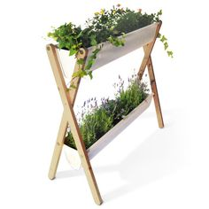 Ein frei stehendes Balkonbeet für Blumen und Kräuter. Die Beine sind aus wetterbeständiger, unbehandelter Lärche. Wasserfest beschichtetes Planenmaterial.