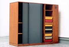 Double wardrobe/room divider, from La Maison du Brésil, Cité Internationale Universitaire de Paris, plastic drawers moulded with 'MODELE CHARLOTTE PERRIAND/BREVETE S.G.D.G.', Designed by Le Corbusier and Charlotte Perriand, 1957-59