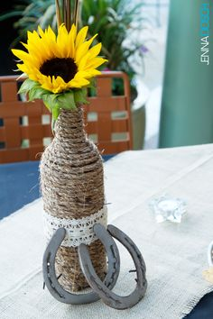Country & Western Inspired Wedding Centerpiece - sunflowers, horseshoes & wine bottle.