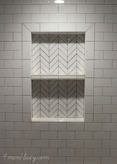 Herringbone tile mosaic made from rectangular subway tiles. Take one subway tile, cut in half long ways, then cut both ends at a 45 degree angle.  Instant tile mosaic! 4men1lady.com