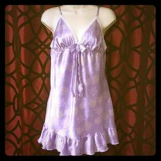 Victoria's Secret nightgown Super cute Victoria's Secret nightgown violet with small groups of diferent color flowers throughout it , it has a cute bow on the bust area with white lace Victoria's Secret Intimates & Sleepwear Chemises & Slips