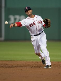 Mar 15, 2014; Fort Myers, FL, USA; Boston Red Sox second baseman Dustin Pedroia (15) throws the ball during the first inning against the Phi...