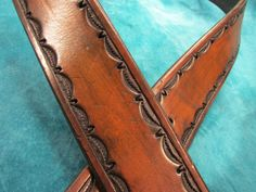 1 3/4 wide, medium brown antique finish, heavy (10-11 oz.) leather belt with hand tooled border pattern in belt size 42. Cut from a Hermann Oak