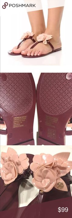 TORY BURCH BLOSSOM JELLY THONG SANDAL ROSE SIZE 10 BRAND NEW ! TORY BURCH  Fiercely feminine and blooming with style is the Tory Burch 'Blossom'. A beloved jelly thong is adorned with a layered rose and topped with a branded 'double T'. A lovely look style that can be worn poolside or out for dinner.  Rubber upper Rubber floral adornment with metallic logo emblem Rubber sole Gold toned nail head hardware  burgundy color size 10  Fast shipping  Happy bidding  Please check out my other great…