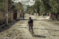 Boy biking in #Haiti #haiti#biking #streetphotography #streetscene #ScenesInDreams #fb