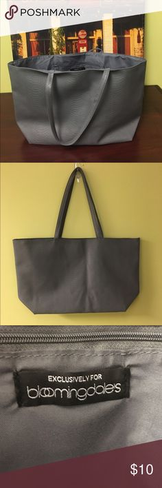 New!! ⭐️ Grey Bag. Exclusively for Bloomingdales Large grey shoulder bag. Exclusively for Bloomingdale's. Large interior with one zipper pocket. There is no closure, the bag stays open. Pefect for overnight bag, gym bag or commuter bag for extra shoes. Bloomingdale's Bags Shoulder Bags