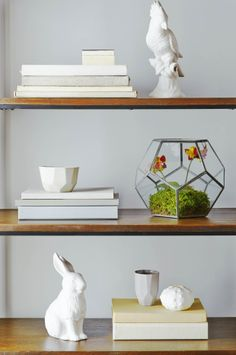 Build a balanced composition on your bookcase for a soothing, minimalist effect.