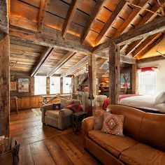 Everything about this room is on point! The beams, the mix of leathers, those floors, the southwest pillows. Amazing!