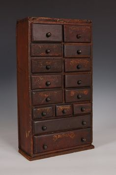 Early set of drawers in original red paint and painted labels.~♥~ lots of floss for needlepunch work fit in here Primitive Furniture, Primitive Antiques, Country Furniture, Antique Furniture, Old Cabinets, Spice Cabinets, Antique Cabinets, Old Wooden Boxes, Drawer Table
