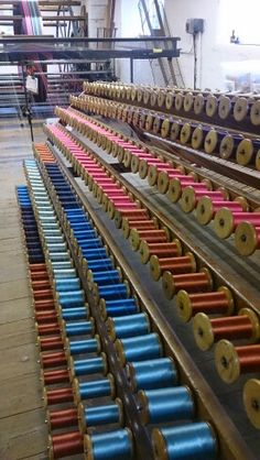 The creel loaded with bobbins for the Peter Pilgrim bicentenary silk #whitchurchsilkmill #warp #creel #bobbins