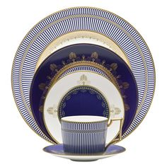 Wedgwood Anthemion Blue. LOVE. The price per placesetting is astronomical, but someday, when I have craptons of money to spend on beautiful dishes, I will hunt them down and buy them.