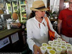 Serving guarapo juice - little Havana food tour at www.miamiculinarytours.com