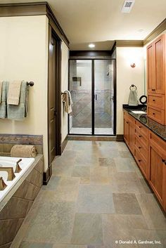 The flooring and shower tiles create a unified look in this master bathroom. The Riva Ridge #5013