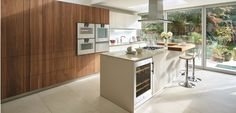 Dreamy warm kitchen with walnut cabinetry and brilliant storage solutions.