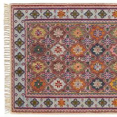 LONESTAR DHURRIE RUG - A handmade patterned dhurrie rug—inspired by an antique rug discovered in Texas—in which a traditional kilim design does the two-step with the wide open skies of the American South.